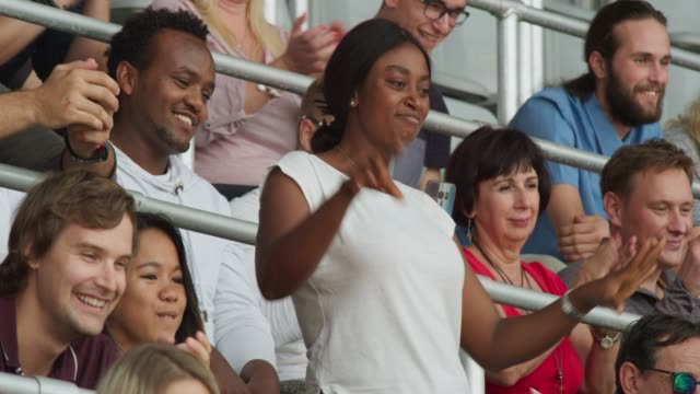woman cheering on the stadium tribune - match sport stock videos & royalty-free footage