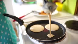 Woman chef pouring pancake batter on a frying pan.