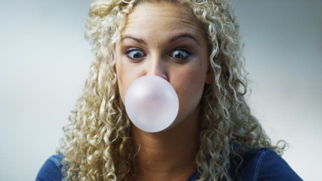 woman chewing bubble gum