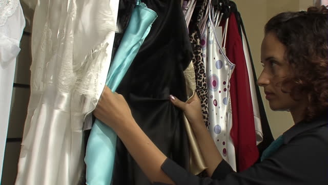 woman chooses negligee in the shop - nightwear stock videos & royalty-free footage