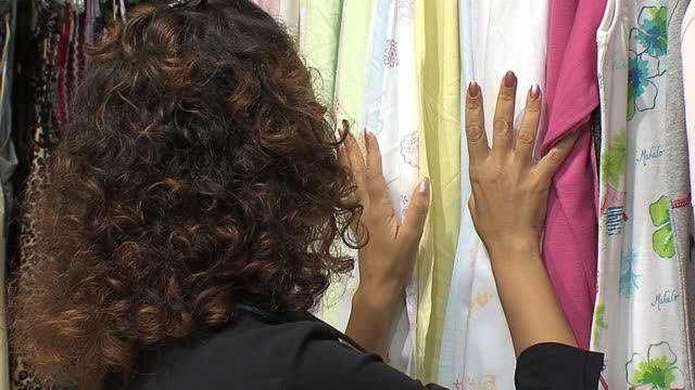 woman chooses night gown in clothes shop - nightwear stock videos & royalty-free footage