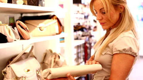woman choosing a purse. - boutique stock videos & royalty-free footage