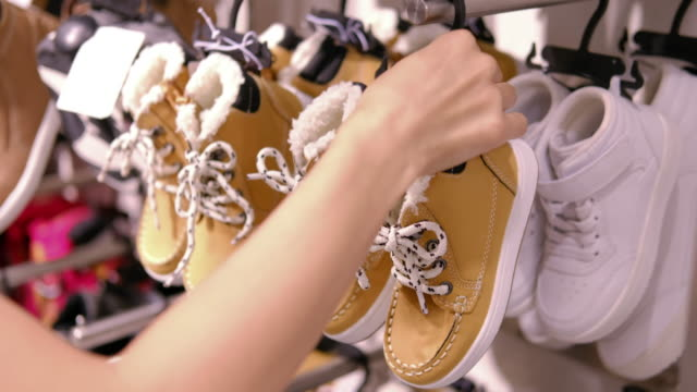 woman choosing children shoes - new stock videos & royalty-free footage