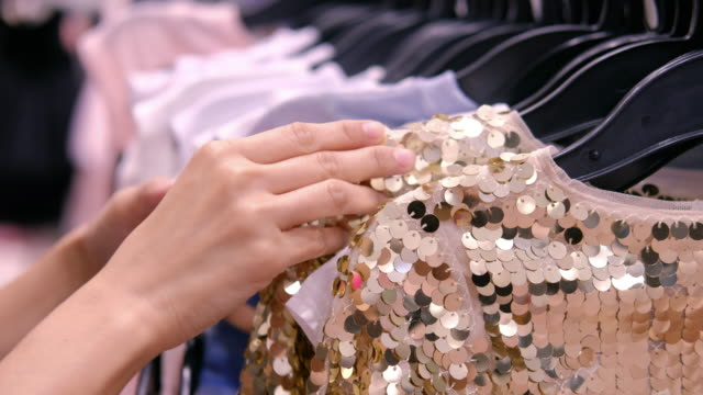 woman choosing clothes - new stock videos & royalty-free footage