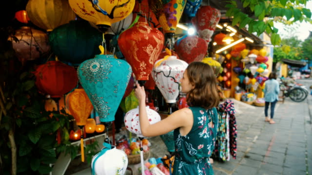 woman choosing lanterns in hoi an - souvenir stock videos and b-roll footage