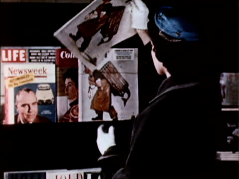 1956 ms woman choosing magazines from newsstand magazine rack / usa - magazine stock videos & royalty-free footage