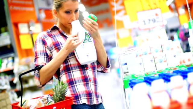 woman choosing some food in supermarket. - cleaning agent stock videos & royalty-free footage