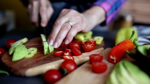 woman chopping avocado - avocado salad stock videos & royalty-free footage