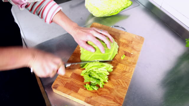 woman chopping cabbage - schneiden stock videos & royalty-free footage