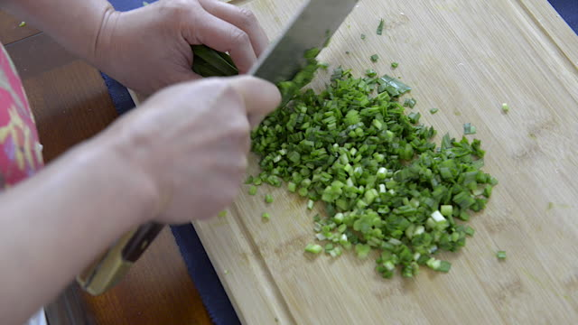 woman chopping garlic chives - scallion stock videos & royalty-free footage