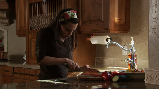 Woman chopping in kitchen