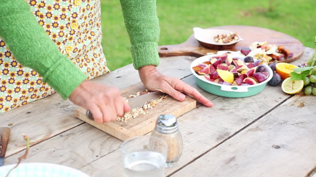 woman chopping nuts outdoors - almond stock videos & royalty-free footage