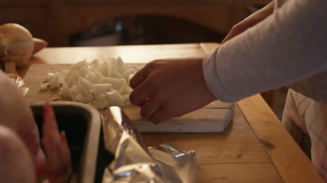 woman chopping onion - cut video transition stock videos & royalty-free footage