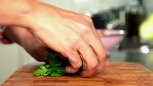 woman chopping parsley - schneiden stock videos & royalty-free footage