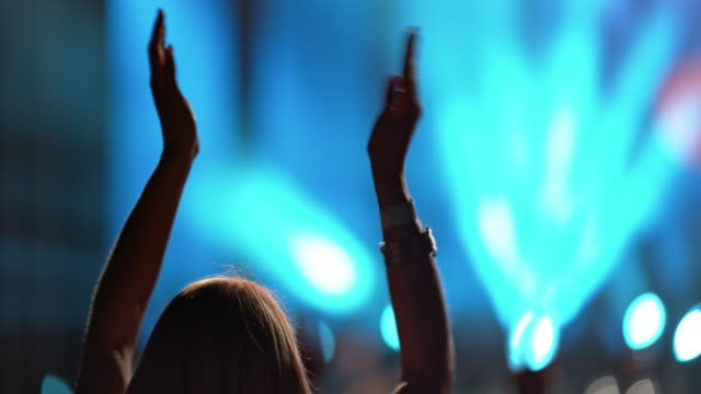 ld woman clapping hands at a concert in the evening - vrhnika stock videos and b-roll footage