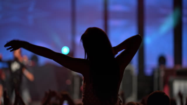 woman clapping hands on man's shoulders at concert - popular music concert stock videos & royalty-free footage