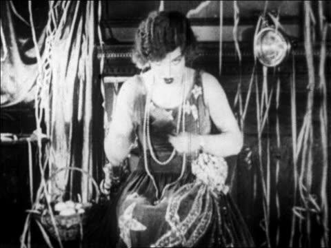 b/w 1928 woman clapping + nodding in nightclub floor show / newsreel - 1928 stock videos & royalty-free footage