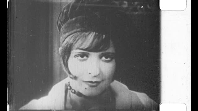 woman - clara bow - standing in doorway looking and thinking - desire stock videos & royalty-free footage