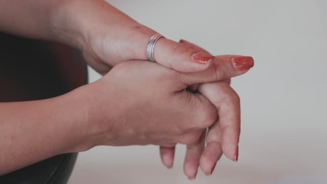 woman clasping hands in prayer position - saving up for a rainy day stock videos and b-roll footage
