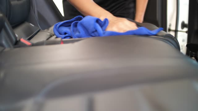 slo mo, woman clean her car seat - polishing stock videos & royalty-free footage