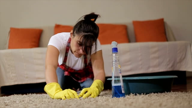 woman cleaning a carpet - hygiene stock videos & royalty-free footage