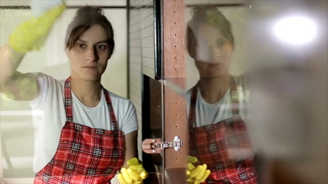woman cleaning a glass on the window - apron stock videos & royalty-free footage