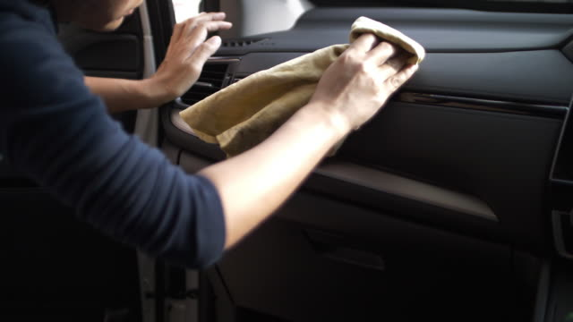 woman cleaning car interior - cleaner stock videos and b-roll footage