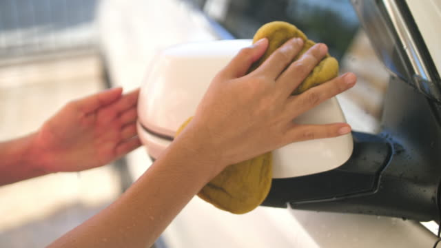 slo mo woman cleaning car with sponge - rubbing stock videos and b-roll footage