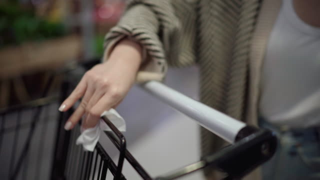 woman cleaning cart for shopping at supermarket - push cart stock videos & royalty-free footage