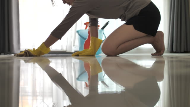 woman cleaning floor - pavimento video stock e b–roll