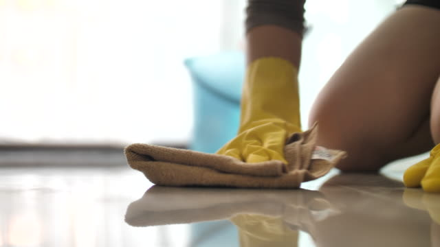 woman cleaning her floor at home - glove stock videos & royalty-free footage