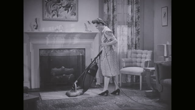 MS PAN Woman cleaning house with vacuum cleaner / United States