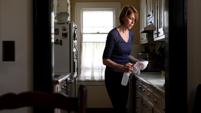 woman cleaning kitchen counter - only mature women stock videos & royalty-free footage
