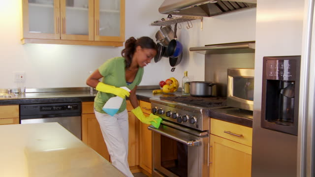 woman cleaning kitchen - washing up glove stock videos & royalty-free footage
