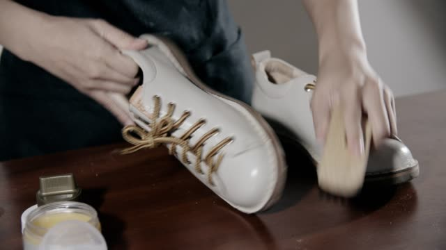 woman cleaning leather shoes at home - polishing stock videos & royalty-free footage