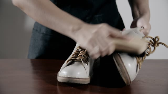woman cleaning leather shoes at home - footwear stock videos & royalty-free footage