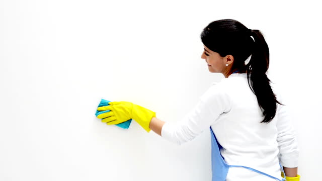 Woman cleaning the walls