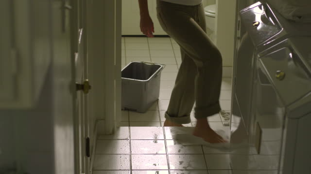 stockvideo's en b-roll-footage met ms, tu, td, woman cleaning tile floor in laundry room, hollywood, california, usa - betegelde vloer