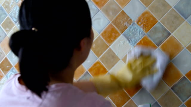 woman cleaning tiles at home - tile stock videos & royalty-free footage