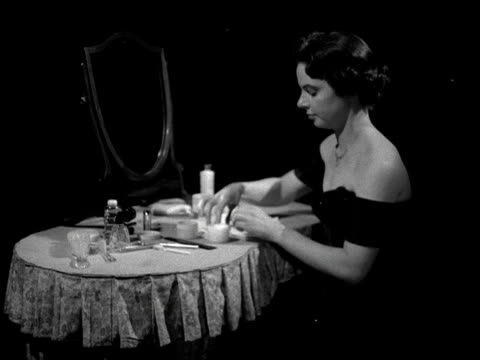 woman cleans her face at a dressing table. - skin care stock videos & royalty-free footage