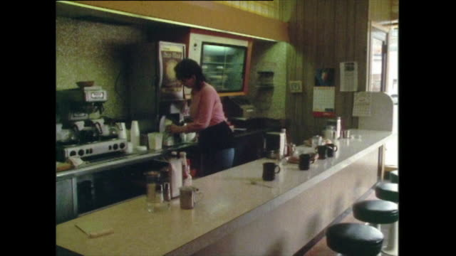 a woman cleans surfaces in an empty diner; chicago, 1985 - one mid adult woman only stock videos & royalty-free footage