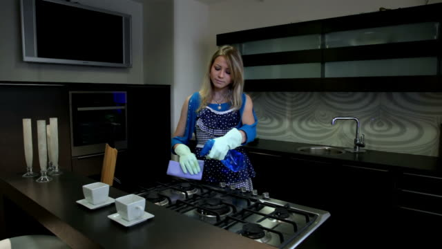 woman cleans the cooker in kitchen - washing up glove stock videos & royalty-free footage