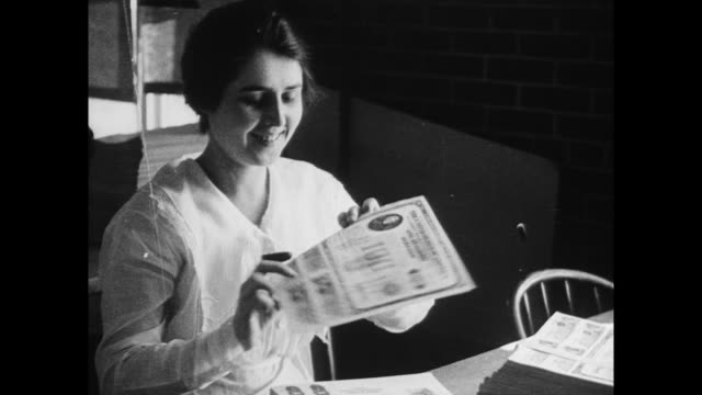 woman clerk working in us victory loan office / man buying liberty bonds - boy scouts of america stock videos and b-roll footage