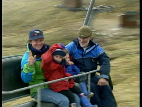 scotland ben nevis ms alison hargreaves with man and her two children on chair lift and waving as last lr ms alison and children off chairlift towards - ski lift stock videos & royalty-free footage