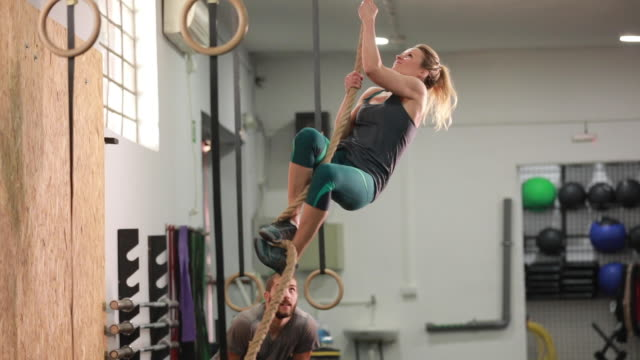 woman climbing a rope - clambering stock videos & royalty-free footage
