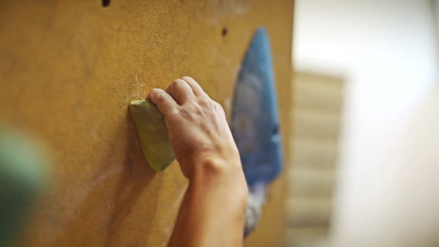 woman climbing and bouldering - climbing wall stock videos & royalty-free footage