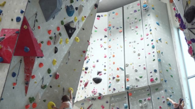 woman climbing on climbing wall - free climbing stock videos & royalty-free footage