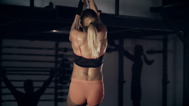 woman climbing on gym rope - climbing rope stock videos & royalty-free footage