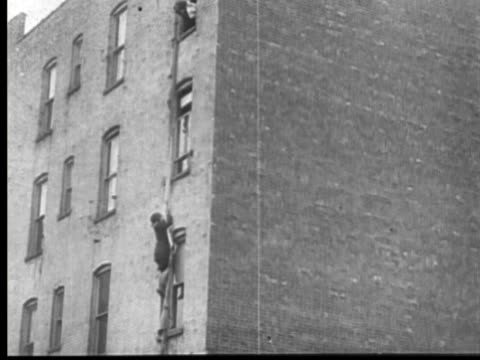 1913 b/w montage ws td woman (mary fuller) climbing out window using bed sheets / usa - 1913 stock videos & royalty-free footage