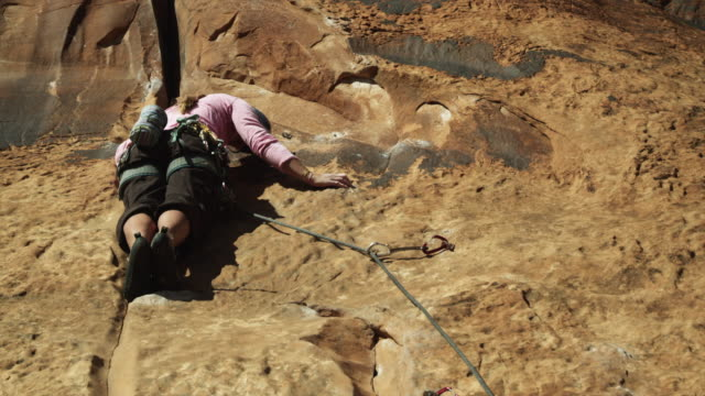ws woman climbing rock / moab, utah, usa - climbing equipment stock videos & royalty-free footage